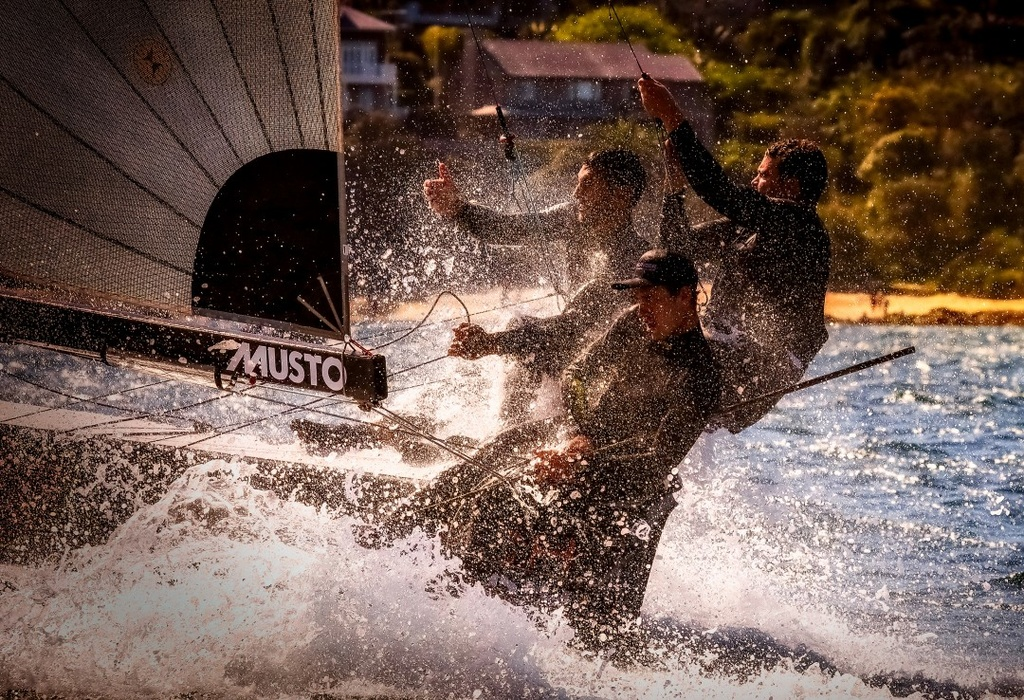 Harry Price, Paul MacKenzie and Matt Stenta on the 4.9-meter «Skeefer» Sutech during the first Point Score race in Sydney Bay. «I've always wanted to try to take a picture of what it's like to be on the Scythian. Specifically that day it was wet and crazy»,