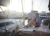 Some people think that you have to buy a lot of equipment to sail a boat, but you don't. Choose light-soled shoes and dress up as usual on vacation.