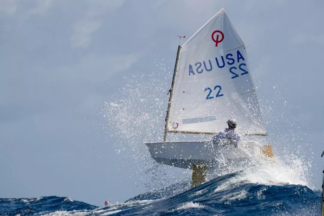American Tommy Sitzmann confronts waves at his «Optimist» Regatta during the St Thomas International Optimist Regatta in the Virgin Islands in the Caribbean Sea.